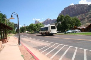 Zion_Transporation_System-Springdale-Bus_heading_NB_into_Park_s